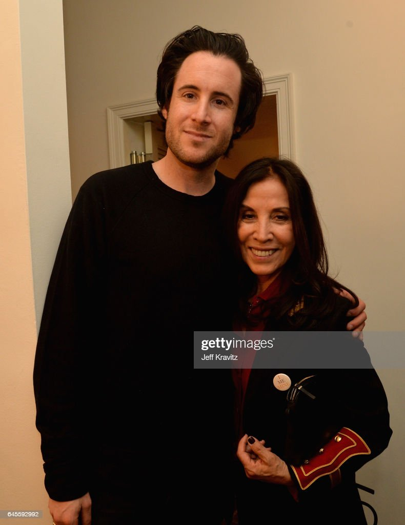 Music manager David Zonshine and author Olivia Harrison