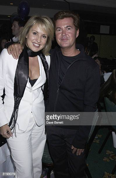 Music managers Nicki Chapman and Simon Fuller attend the O2 Woman of The Year Awards held at The Intercontinental Hotel on 29th November 2002 in...