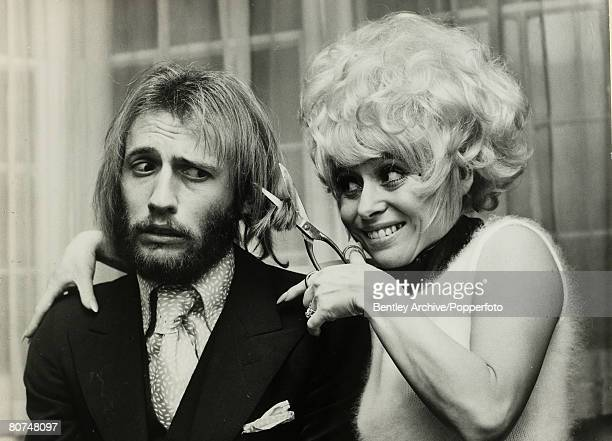 Music Member of the British pop group The Bee Gees Maurice Gibb has a lock of his hair removed by actress Barbara Windsor