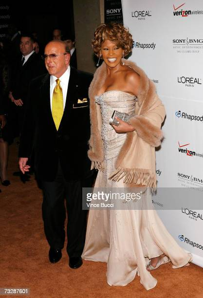 Music mogul Clive Davis and singer Whitney Houston arrive at the Clive Davis preGrammy party held at the Beverly Hilton on February 10 2007 in...