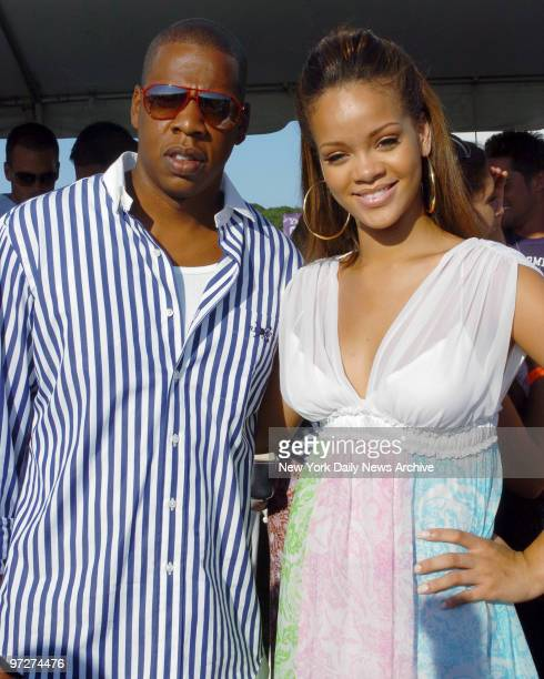 Music mogul JayZ gets together with singer Rihanna of Barbados on the second weekend of the annual MercedesBenz Polo Challenge at the Bridgehampton...