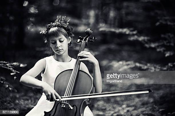 Music of nature - little girl playing cello