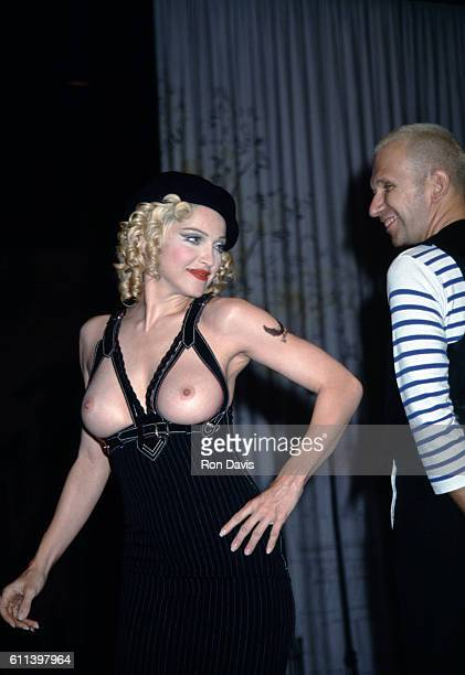 Music performer and actress Madonna exposes her breasts in front of 6000 people at a JeanPaul Gaultier fashion show benefit at the Shrine Auditorium...