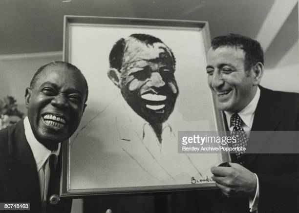 Music Personalities England 29th October 1970 American jazz musician Louis Satchmo Armstrong pictured in London being presented with a portrait of...