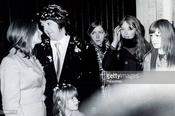 12th March 1969 Paul McCartney the last of the Beatles to marry poses with his bride Linda Eastman and her daughter Heather after their wedding at...