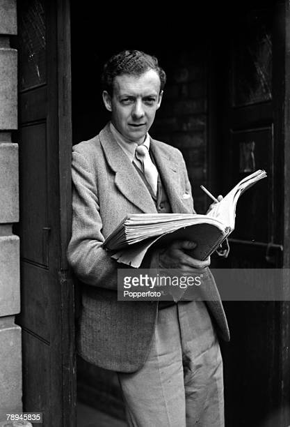 29th May 1945 English composer Benjamin Britten pictured outside London's Sadlers Wells Theatre with his script for Peter Grimes