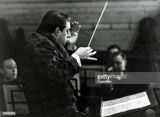 Music Personalities, pic: circa 1949, Manchester, Sir John Barbirolli, celebrated English conductor, pictured working with the Halle Orchestra,...