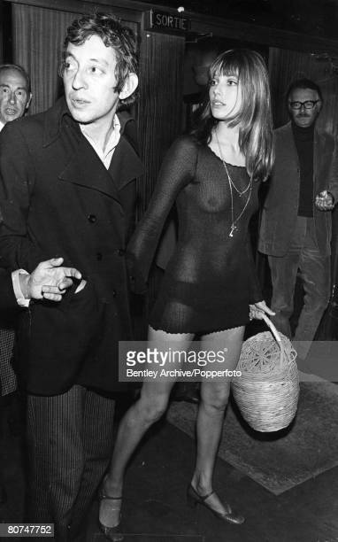 circa 1970 French singer/songwriter/director Serge Gainsbourg pictured with his girlfriend the provocatively dressed English actress Jane Birkin