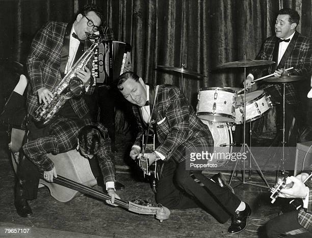 Music Personalities 'Rock and Roll' pic February 1957 Dominion Theatre London American 'rock and roll' legend Bill Haley 2nd right born 1925 on stage...