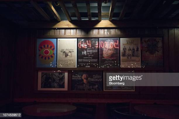Music posters are displayed at the Saxon Pub in Austin Texas US on Thursday Dec 20 2018 Apple Inc announced this month it's opening new offices in...