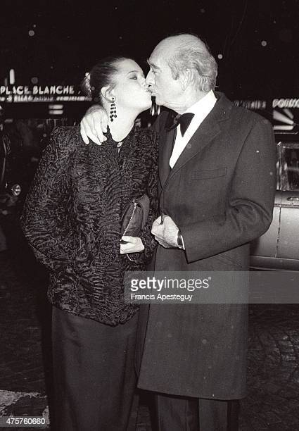 Music producer and publisher Eddie Barclay with his seventh wife Cathy Esposito at the Moulin Rouge Le producteur et editeur de musique Eddie Barclay...