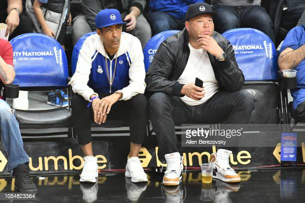 Music producer Chris Ivery and a friend attend a basketball game between the Los Angeles Clippers and the Washington Wizzards at Staples Center on...