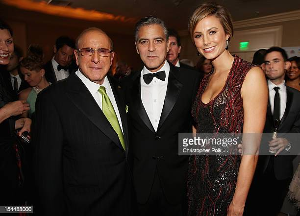 Music producer Clive Davis actors George Clooney and Stacy Keibler attend the 26th Anniversary Carousel Of Hope Ball presented by MercedesBenz at The...