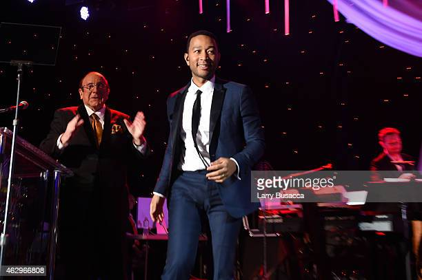 Music producer Clive Davis and recording artist John Legend speak onstage at the PreGRAMMY Gala and Salute To Industry Icons honoring Martin Bandier...