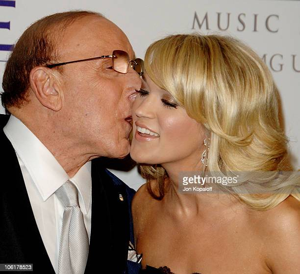 Music producer Clive Davis and singer Carrie Underwood arrive to the Clive Davis PreGrammy Party at the Beverly Hilton Hotel on February 9 2008 in...