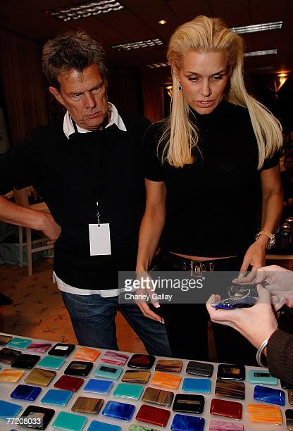 Music producer David Foster and Yolanda Hadid peruse the '9 Manning Square' glass belt buckles by Meg Reagan at the Distinctive Assets Gift Lounge...