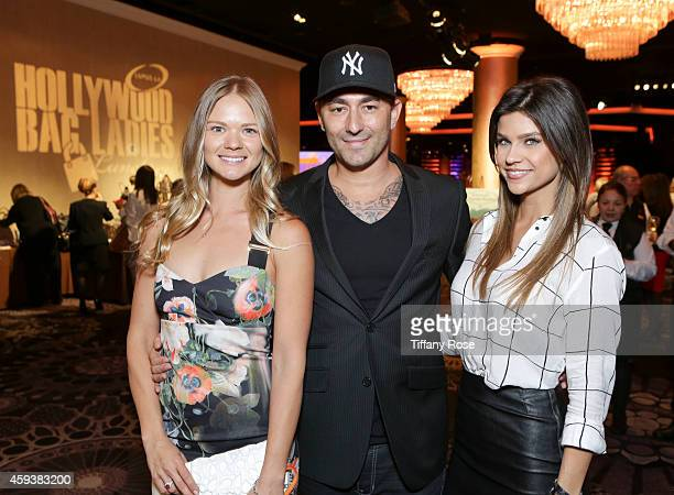 Music producer Dennis DeSantis and guests attend the Lupus LA Hollywood Bag Ladies Luncheon on November 21 2014 in Beverly Hills California