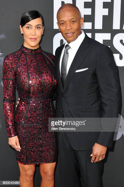 Music producer Dr Dre and wife Nicole Young attend the premiere of HBO's The Defiant Ones at Paramount Theatre on June 22 2017 in Hollywood California