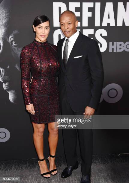 Music producer Dr Dre and wife Nicole Young attend the premiere of HBO's 'The Defiant Ones' at Paramount Theatre on June 22 2017 in Hollywood...
