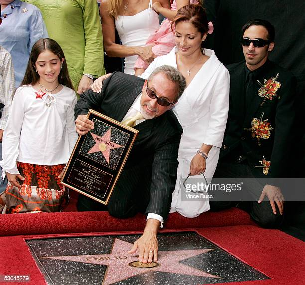 Music producer Emilio Estefan poses with his daughter Emily son Nayib and wife Gloria at the ceremony honoring him with a star on the Hollywood Walk...