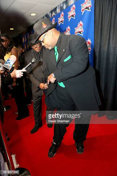 Music Producer Jimmy Jam Harris shows off his shoes on the AllStar Red Carpet prior to the 2013 NBA AllStar Game presented by Kia Motors on February...