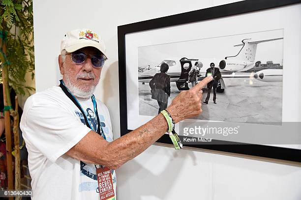 Music producer Lou Adler points to himself in a photo at the Desert Trip Photography Experience during Desert Trip at The Empire Polo Club on October...