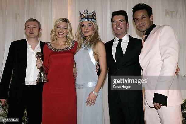 Music producer Louis Walsh TV presenter Kate Thornton Miss World 2006 Tatana Kucharova music producer Simon Cowell and singer Chico Slimani pose in...
