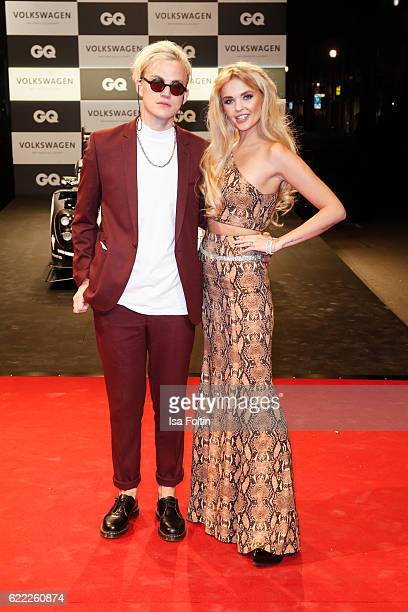 Music producer Markus Brueckner alias PsaikoDino and his girlfriend model and fashion designer Bonnie Strange attend the GQ Men of the year Award...