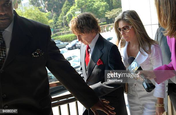 Music producer Phil Spector center and wife Rachelle Short right arrive at Los Angeles Superior Court Tuesday Sept 18 in Los Angeles California US...