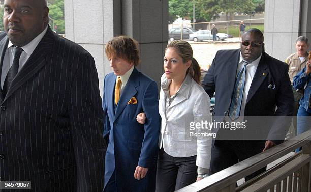 Music producer Phil Spector, center left, arrives at Los Angeles Superior Court with his wife Rachelle Short, center right, on Wednesday, Sept. 19 in...