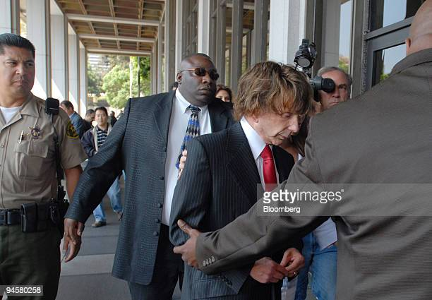 Music producer Phil Spector, center, with red tie, arrives at Los Angeles Superior Court, Tuesday, Sept. 18 in Los Angeles, California, U.S. The jury...