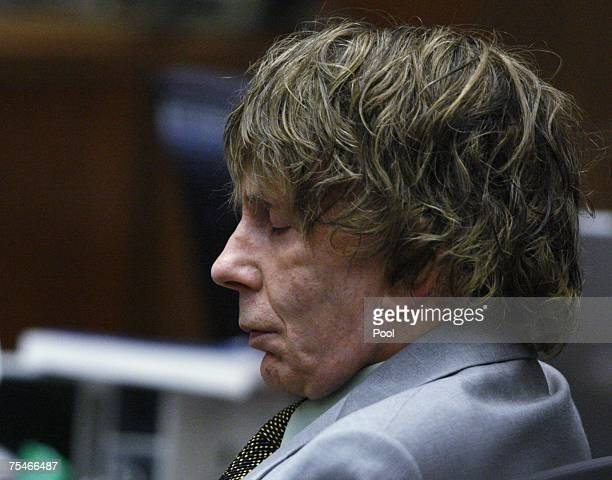 Music producer Phil Spector closes his eyes during his murder trial in Superior Court July 18 2007 in Los Angeles California Spector is accused of...