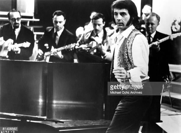 Music producer Phil Spector conducts the band during rehearsals for the concert film The Big T.N.T. Show in 1966 in Los Angeles, California.