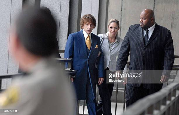 Music producer Phil Spector, left, arrives at Los Angeles Superior Court with his wife Rachelle Short, and an unidentified man, on Wednesday, Sept....