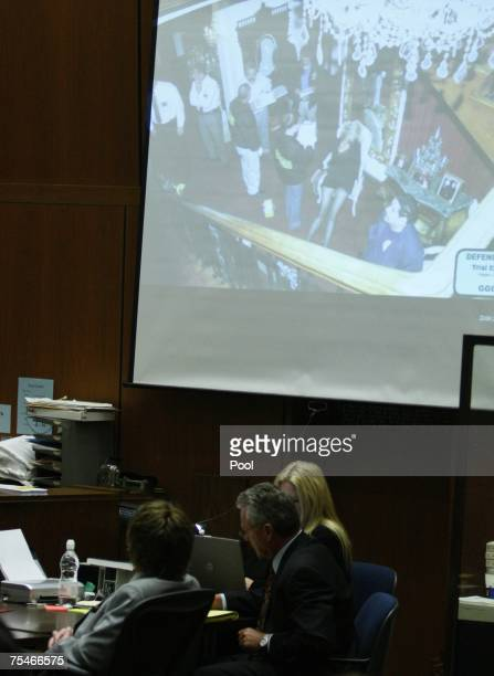 Music producer Phil Spector looks at a photograph projected of actress Lana Clarkson at the crime scene at the his murder trial in Superior Court...