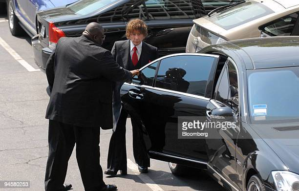 Music producer Phil Spector, right, and an unidentified man, left, arrive at Los Angeles Superior Court, Tuesday, Sept. 18 in Los Angeles,...