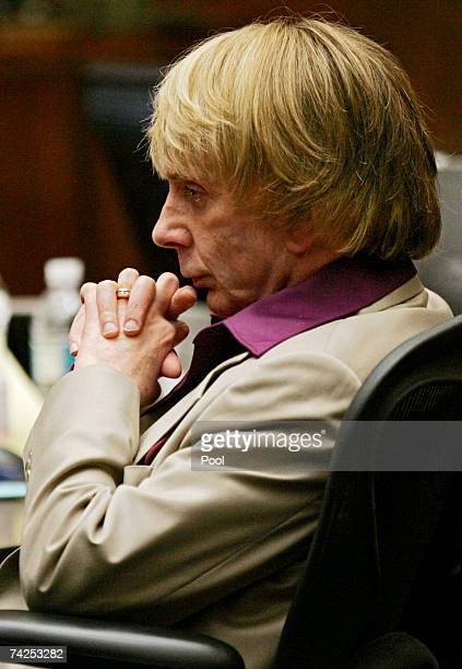 Music producer Phil Spector sits inside the courtroom as photos of actress Lana Clarkson body are shown as evidence during his murder trial at Los...