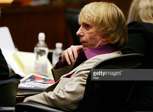 Music producer Phil Spector sits inside the courtroom as photos of actress Lana Clarkson's body are shown as evidence during his murder trial at Los...