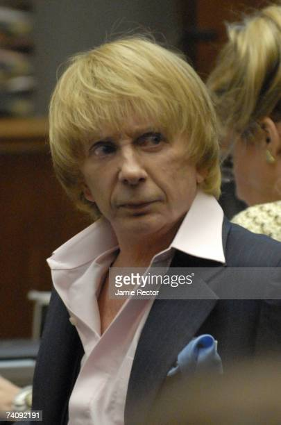 Music producer Phil Spector speaks with Bruce Cutler at the beginning of the third week in his murder trial at Los Angeles Superior Court May 7 2007...