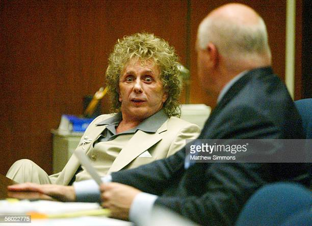 Music Producer Phil Spector speaks with his attorney Bruce Cutler at a PreTrial Conference at the Los Angeles Superior Court on October 27 2005 in...