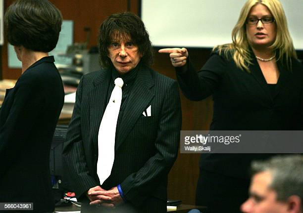Music producer Phil Spector stands in court Wednesday during a retrial in the murder of actress and House of Blues VIP hostess Lana Clarkson