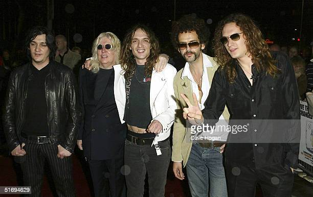Music producer Roy Thomas Baker and members of The Darkness Ed Graham Justin Hawkins Frankie Poullain and Dan Hawkins arrive at the premiere...