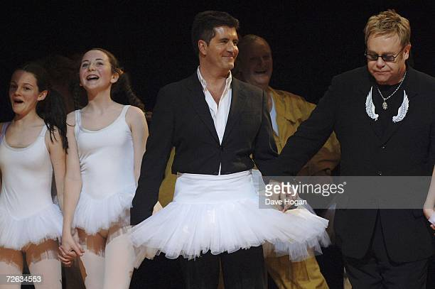 "Music producer Simon Cowell and musician Sir Elton John appear on stage for the curtain call of the charity gala performance of ""Billy Elliott: The..."
