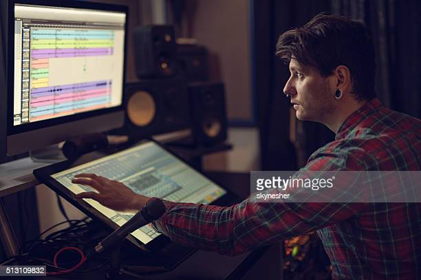 music producer working in recording studio. - producer stock pictures, royalty-free photos & images