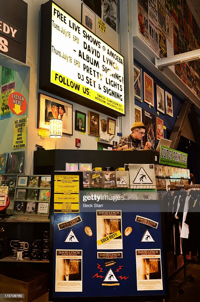 Music producer/DJ Dean Hurley spins as director/musician David Lynch signs copies of his new album 'The Big Dream' at Amoeba Music on July 16, 2013 in Hollywood, California.