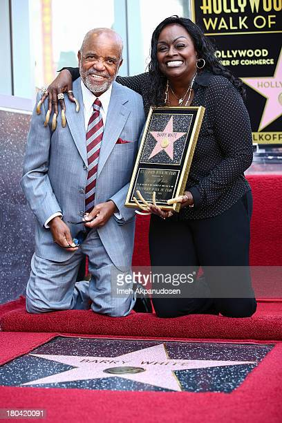 Music producer/songwriter Berry Gordy and singer Glodean White pose for a photo as the late Barry White was honored posthumously with a star on the...