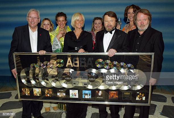 Music promoter Pete Waterman poses with singers Frida Lyngstad Bjorn Ulvaeus and Benny Andersson of ABBA backstage at the fifth anniversary...