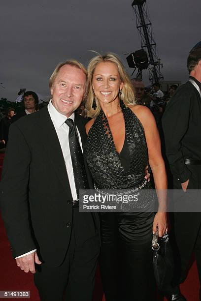 Music promotor Glenn Wheatley and his wife arrive for the 2004 ARIA Awards at the Superdome October 17 2004 in Sydney Australia