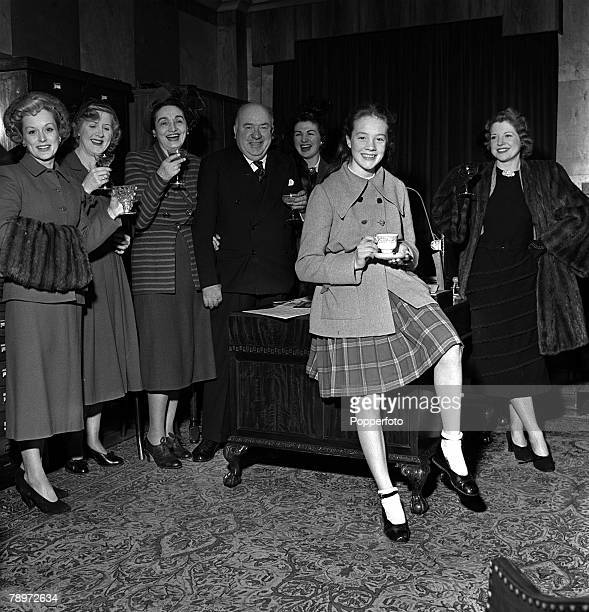 Music publisher Lawrence Wright with some of his stars drink a toast to pantomime starlet Julie Andrews othes are LR Carole Lynne Dorothy Ward Marie...