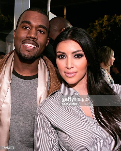 Music recording artist Kanye West left and socialite Kim Kardashian attend the grand opening of Intermix on September 25 2007 in Los Angeles...
